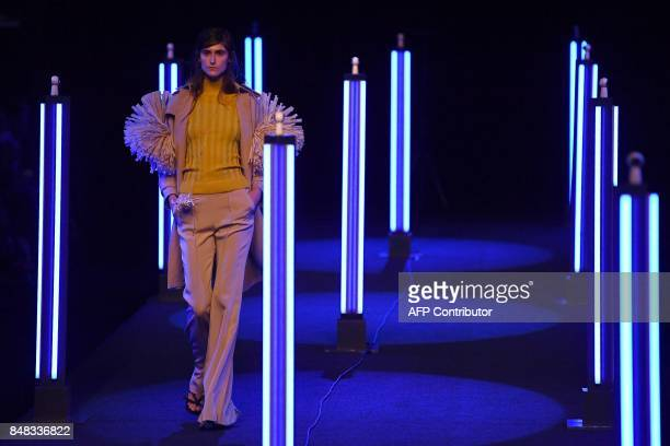 A model presents a creation of Juan Vidal's Spring/Summer 2018 collection during the Madrid Fashion Week in Madrid on September 17 2017 / AFP PHOTO /...