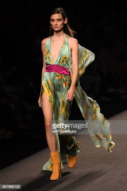 TOPSHOT A model presents a creation of Menchen Tomas's Spring/Summer 2018 collection during the Madrid Fashion Week in Madrid on September 16 2017 /...