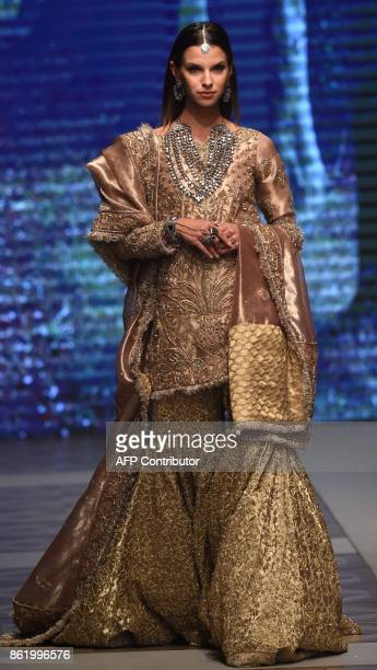 A model presents a creation of Pakistani designers Shazia and Sehr during the final day of the Pakistan Fashion Design Council LOreal Paris Bridal...
