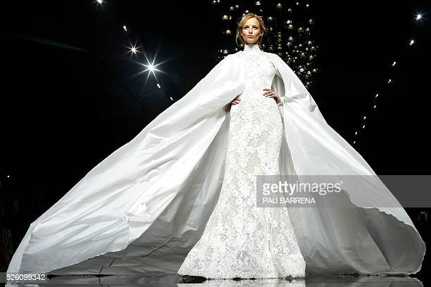 TOPSHOT A model presents a creation of the Pronovias 2016 collection during the last day of the Barcelona Bridal Week in Barcelona on April 29 2016 /...