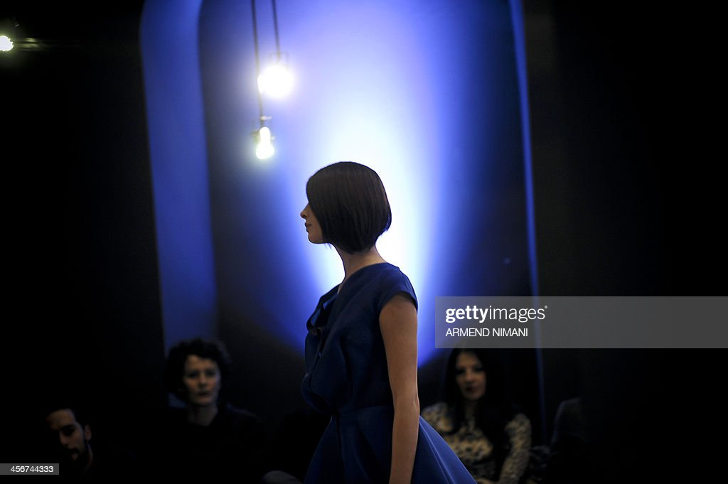 A model presents a creation of the spring/summer collection 'Cinematique' by Kosovar designer Krenare Rugova during a fashion show in Pristina on December 14, 2013. AFP PHOTO / ARMEND NIMANI