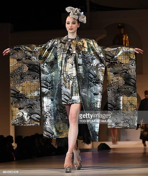 A model presents a creation using 'Yuzen' fabric during the 2015 Yumi Katsura Grand Collection in Tokyo on February 25 2015 Yumi Katsura celebrated...