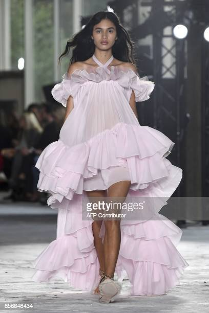A model presents a creations by Giambattista Valli during the women's 2018 Spring/Summer readytowear collection fashion show in Paris on October 2...