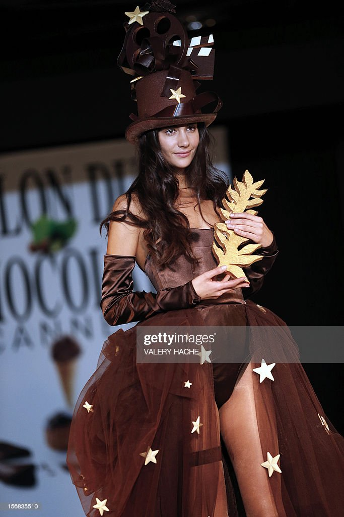 A model presents a dress made of chocolate on November 22, 2012 in Cannes, Southeastern France, during a fashion show for the inauguration of Cannes international chocolate fair. The event runs until November 25, 2012. AFP PHOTO / VALERY HACHE