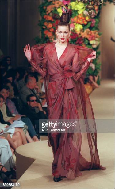 A model presents a sheer gown with shoulder wrap for Yves SaintLaurent during the AutumnWinter 1999/2000 haute couture collections in Paris 21 July...