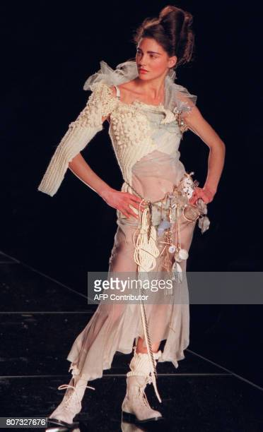 A model presents a silk tulle pants worn with wool embroidered and bead embroidered top of silk organza and silk tulle with a composite belt of...