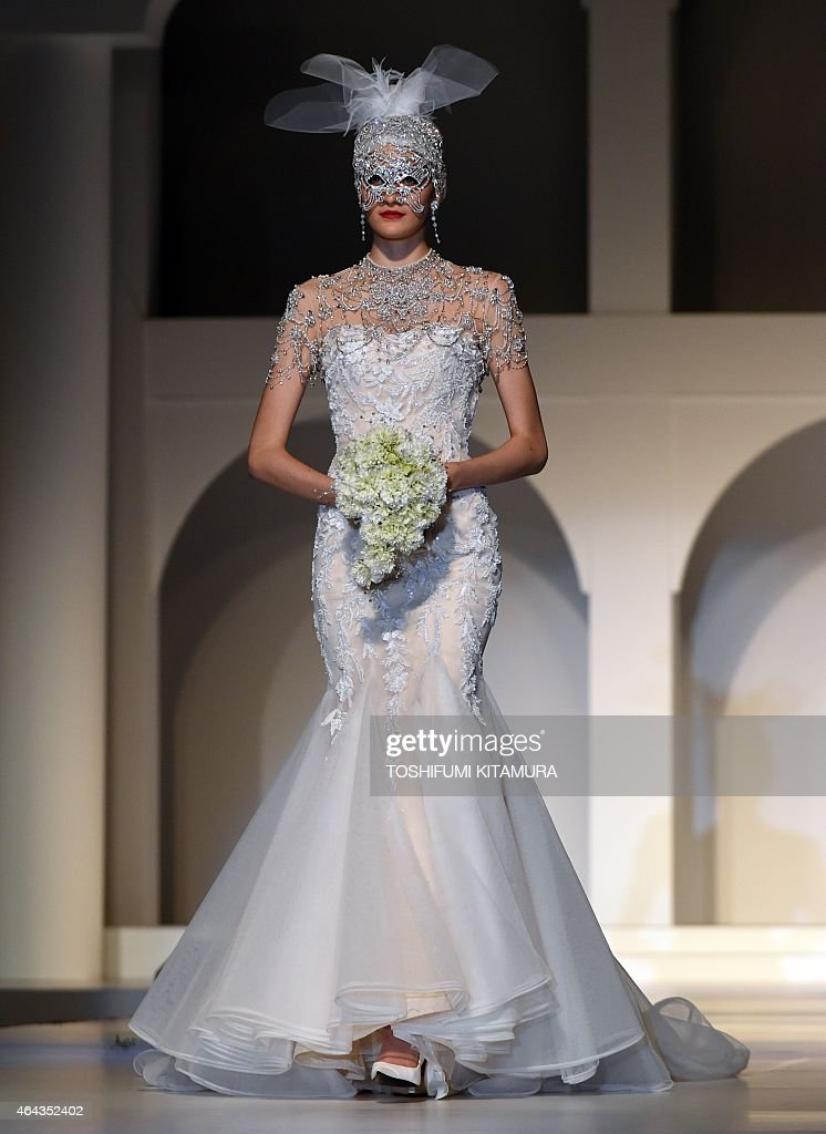 A model presents a wedding dress during the 2015 Yumi Katsura Grand Collection in Tokyo on February 25 2015 Yumi Katsura celebrated the 50th...