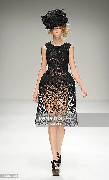 A model presents an outfit by John Rocha for the Spring/Summer 2010 collection on the second day of London Fashion Week in central London on...
