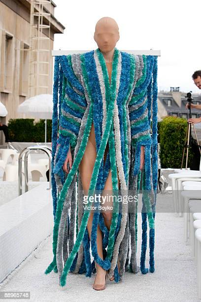 A model presents an outfit by Maison Martin Margiela A/W 200910 Haute Couture at Grand Palais on July 7 2009 in Paris France