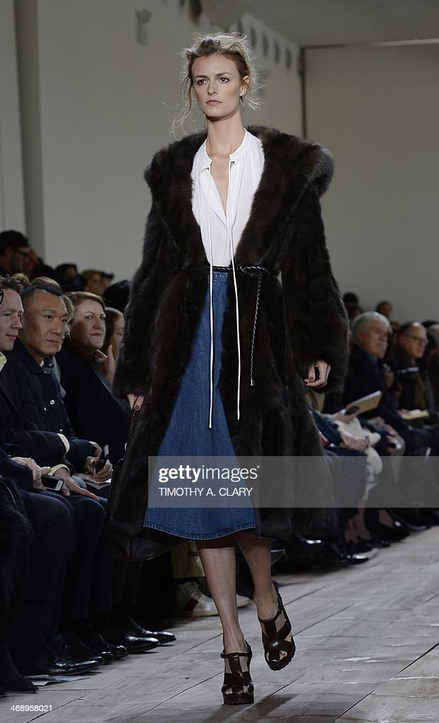 A model presents an outfit by Michael Kors during the Mercedes-Benz Fashion Week Fall/Winter 2014 shows February 12, 2014 in New York. AFP PHOTO/Timothy A. CLARY