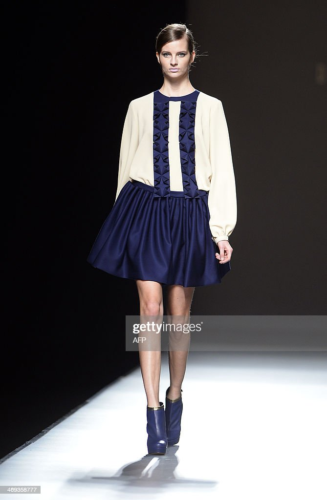 A model presents Autumn/Winter 2014-2015 collection creations by Devota & Lomba during Madrid Fashion Week in Madrid on February 13, 2014.
