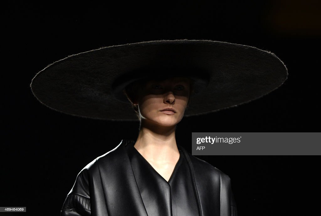 NAME - A model presents Autumn/Winter 2014-2015 collection creations by Martin Lamothe during Madrid Fashion Week in Madrid on February 15, 2014. AFP PHOTO / GERARD JULIEN