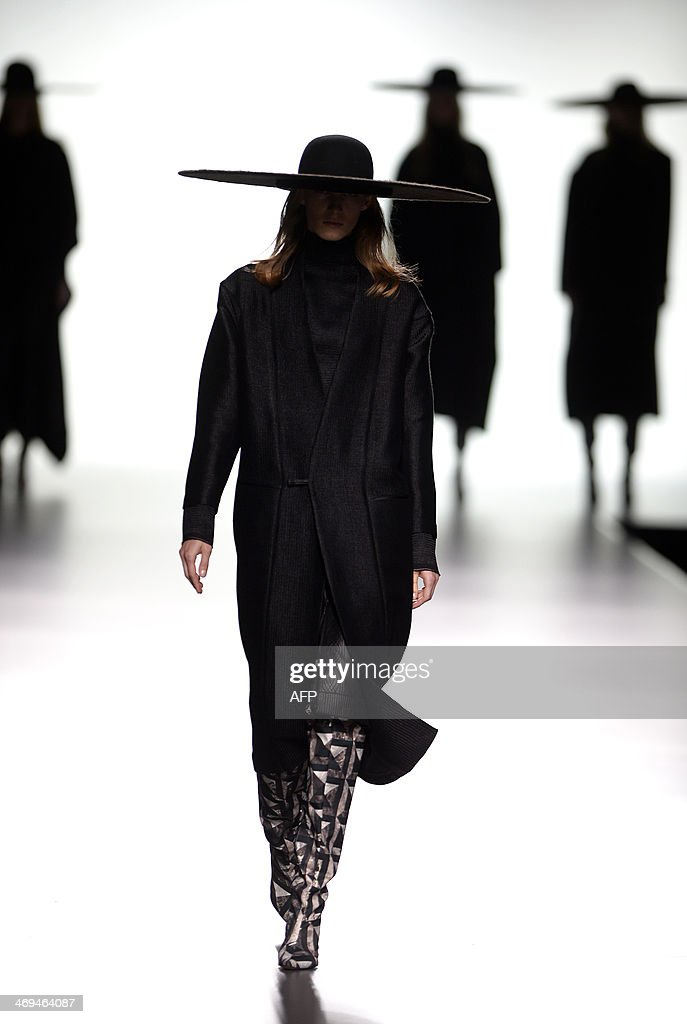NAME - A model presents Autumn/Winter 2014-2015 collection creations by Martin Lamothe during Madrid Fashion Week in Madrid on February 15, 2014.