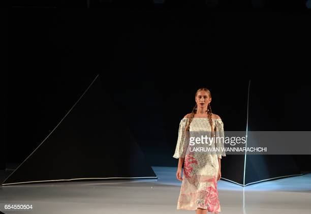 A model presents creations by fashion designer Darshi Keerthisena at the Colombo fashion week in Colombo on March 17 2017 / AFP PHOTO / LAKRUWAN...
