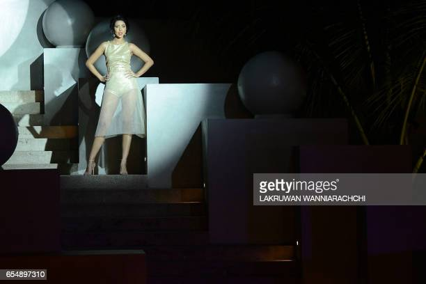 A model presents creations by fashion designer Mihiri de Silva at the Colombo fashion week on March 18 2017 / AFP PHOTO / LAKRUWAN WANNIARACHCHI