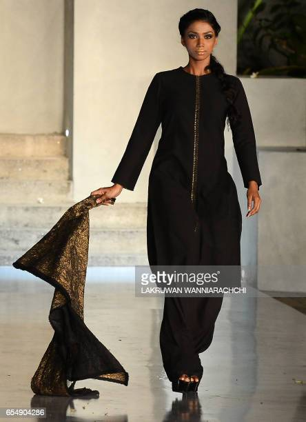 A model presents creations by fashion designers Abraham Thakore at the Colombo fashion week on March 18 2017 / AFP PHOTO / LAKRUWAN WANNIARACHCHI