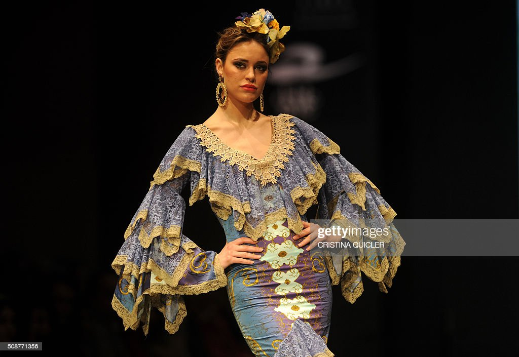 A model presents creations by Loli Vera during the SIMOF 2016 (International Flamenco Fashion Show) in Sevilla, on February 6, 2016. AFP PHOTO/ CRISTINA QUICLER / AFP / CRISTINA QUICLER