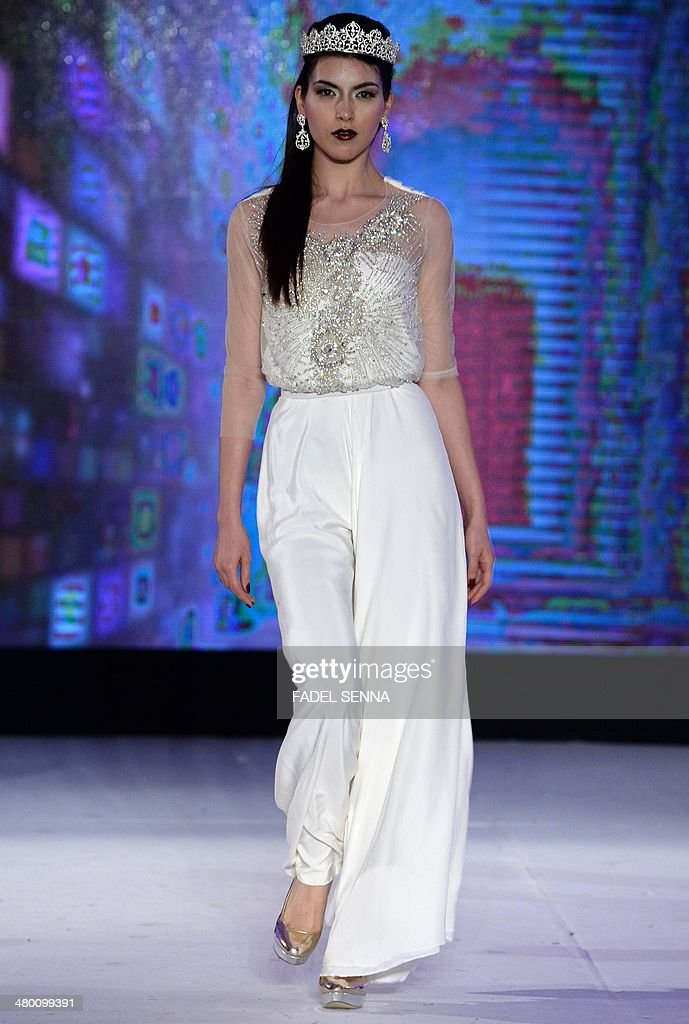A model presents creations by Moroccan fashion designer Meriem Lyoubi Guessous during the 'Fashion days' in Casablanca on March 22 , 2014.