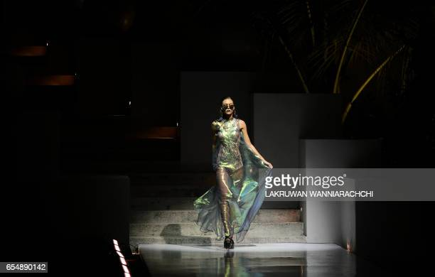 A model presents creations by Sri Lankan born fashion designer Charini Suriyage at the Colombo fashion week on March 18 2017 / AFP PHOTO / LAKRUWAN...