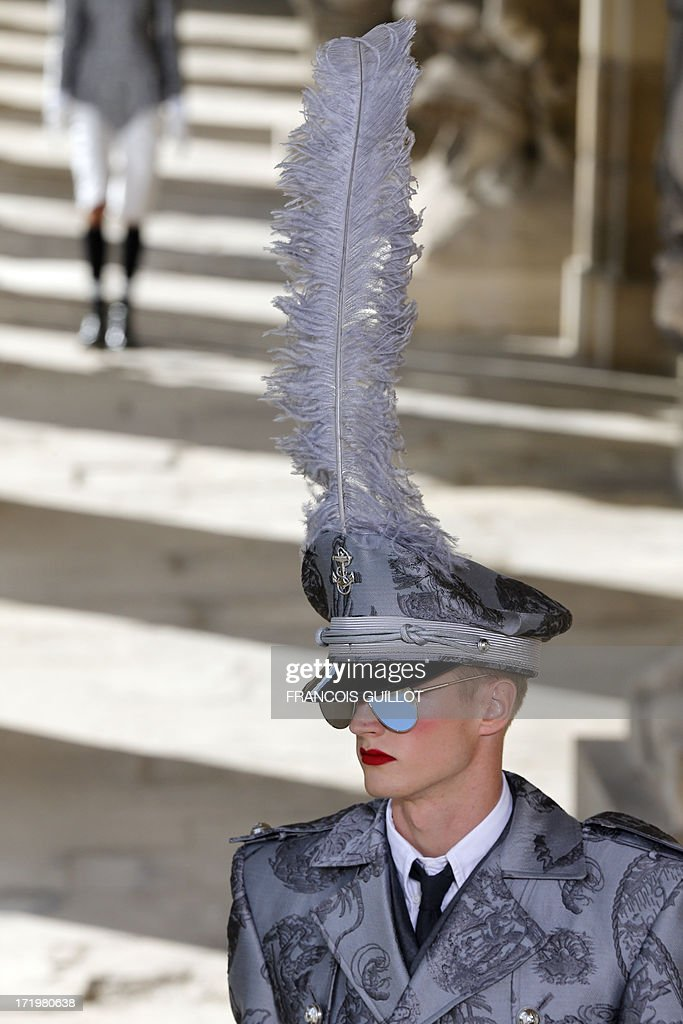 A model presents creations by US fashion designer Thom Browne during the men's spring/summer 2014 ready-to-wear fashion show on June 30, 2013 at the Ecole Militaire (Military Academy) in Paris.