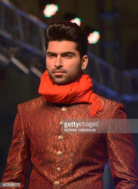 A model presents creations of designer Amir Adnan at the Karachi Fashion Week Men's in Karachi on December 26 2015 / AFP / RIZWAN TABASSUM