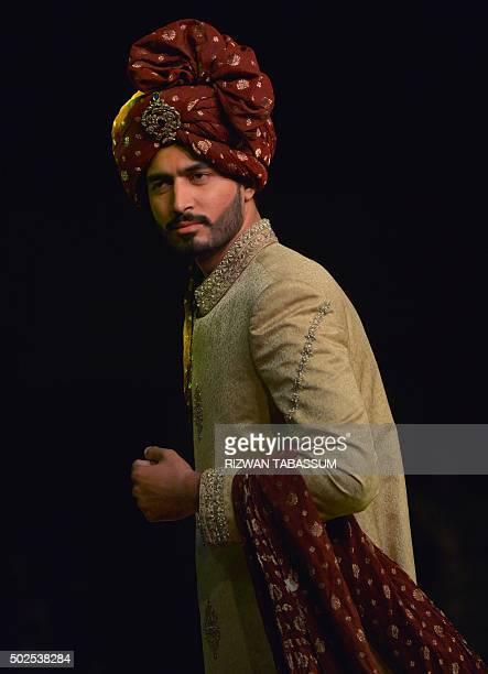 A model presents creations of designer Maaz Jee at the Karachi Fashion Week Men's in Karachi on December 26 2015 / AFP / RIZWAN TABASSUM