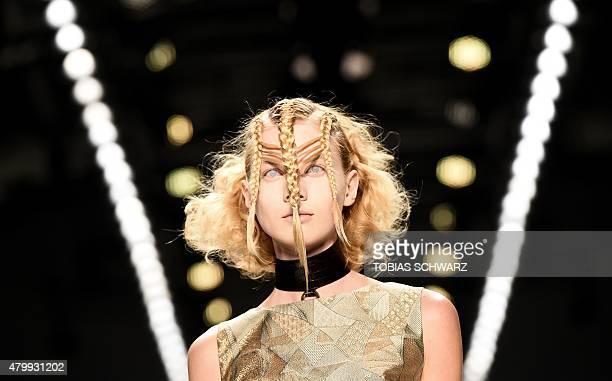 A model presents fashion by German designer Irene Luft at the Berlin Fashion Week SpringSummer 2016 in Berlin on July 8 2015 AFP PHOTO / TOBIAS...