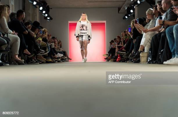 A model presents fashion from the spring/summer 2018 collection of the label 'Atelier About' at the MercedesBenz Fashion Week in Berlin on July 5...