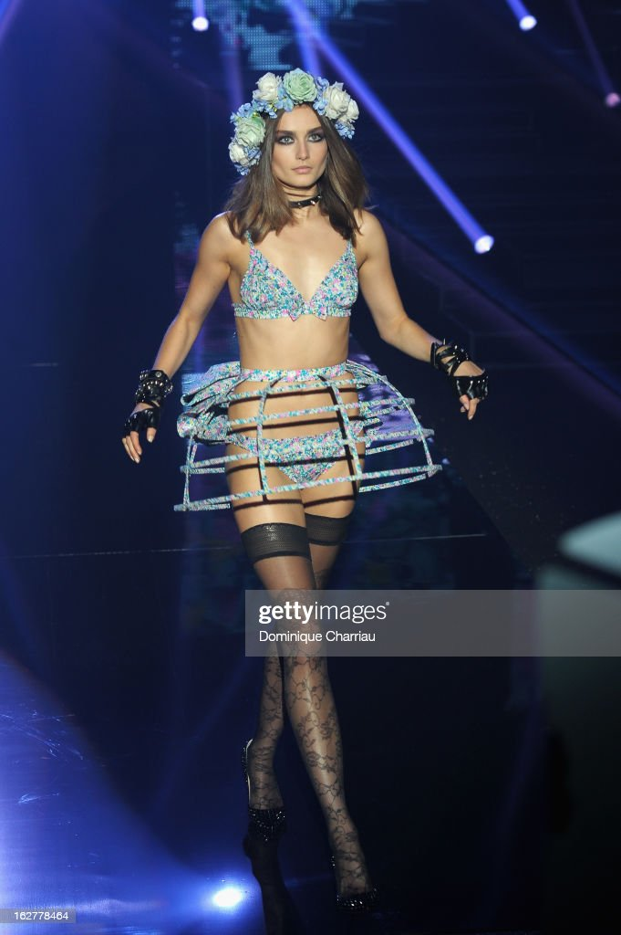 A model presents lingerie creations by former Russian model Natalia Vodianova during the Etam Live Show Lingerie at Bourse du Commerce on February 26, 2013 in Paris, France.
