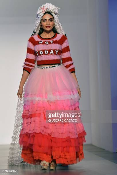 A model presents on the catwalk a creation of MUA MUA Dolls by designer Ludovica Virga during the Arab Fashion Week in the United Arab Emirate of...