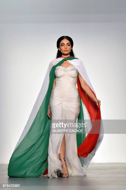A model presents on the catwalk a creation of Renato Balestra during the Arab Fashion Week in the United Arab Emirate of Dubai on November 17 2017 /...