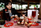 A model presents special Valentines Pralines at Sheraton Hotel on February 10 2014 in Surabaya Indonesia Roses chocolates teddy bears toy hearts...