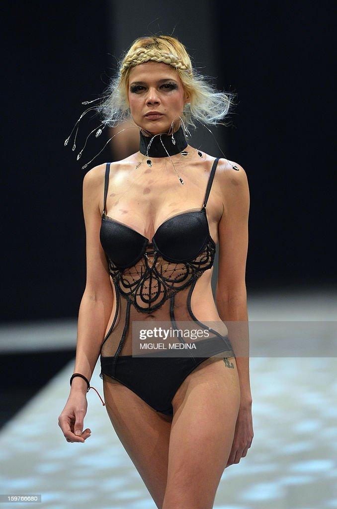 A model presents underwear garments during the Salon de la lingerie (International Lingerie Fair) on January 20, 2013 in Paris. AFP PHOTO MIGUEL MEDINA