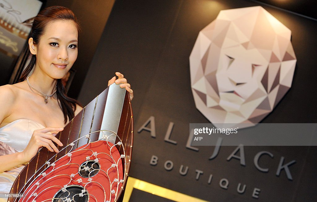 A model promotes an Alljack Boutique Home Theater Audio System at 2012 Computex in Taipei on June 6, 2012. Computex is Asia's leading IT trade fair. AFP PHOTO / Mandy CHENG