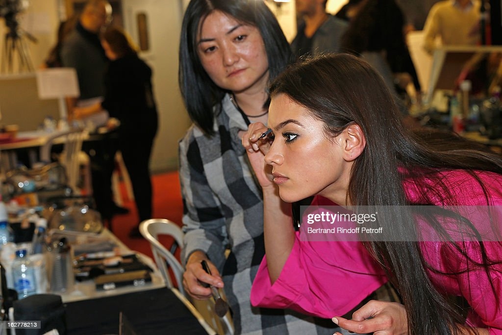 A model puts the final touch to her make up, backstage prior to the Etam Live Show Lingerie at Bourse du Commerce on February 26, 2013 in Paris, France.