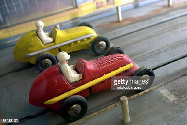 Model race cars on racetrack