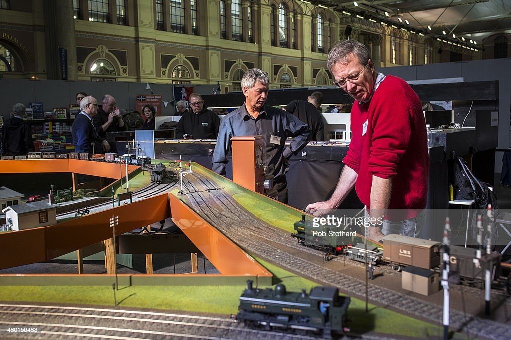 Model railway enthusiasts control working model trains at The London Festival of Railway Modelling at Alexandra Palace on March 23, 2014 in London, England. The London Festival of Railway Modelling will run from 22nd and 23rd March. The exhibition is London's leading railway modelling event, the weekend will see 40 working layouts on display hand-picked by The Model Railway Club with over 100 traders, clubs and societies.