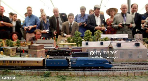 Model railway enthusiasts look on as Hornby launches its first Live Steam Locomotive the Mallard part of it's new 'OO' gauge Live Steam working...