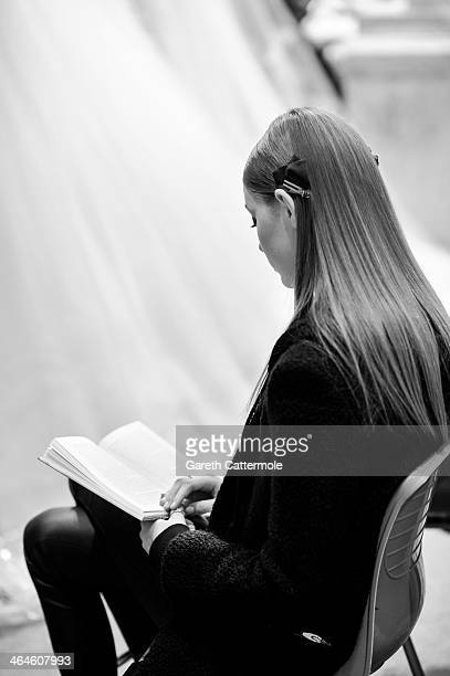 A model reads a book backstage before the Zuhair Murad show as part of Paris Fashion Week HauteCouture Spring/Summer 2014 at Palais des BeauxArts on...