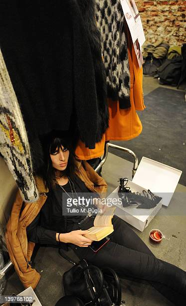 A model reads her book backstage at the Iceberg Autumn/Winter 2012/2013 fashion show as part of Milan Womenswear Fashion Week on February 24 2012 in...