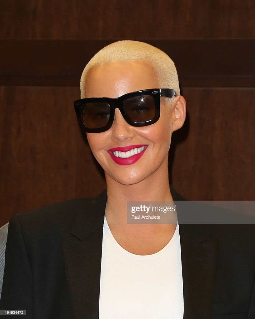 Reality Tv Personality Amber Rose Signs Copys Of Her New Book 'how To Amber  Rose Become A Fashion Photographer