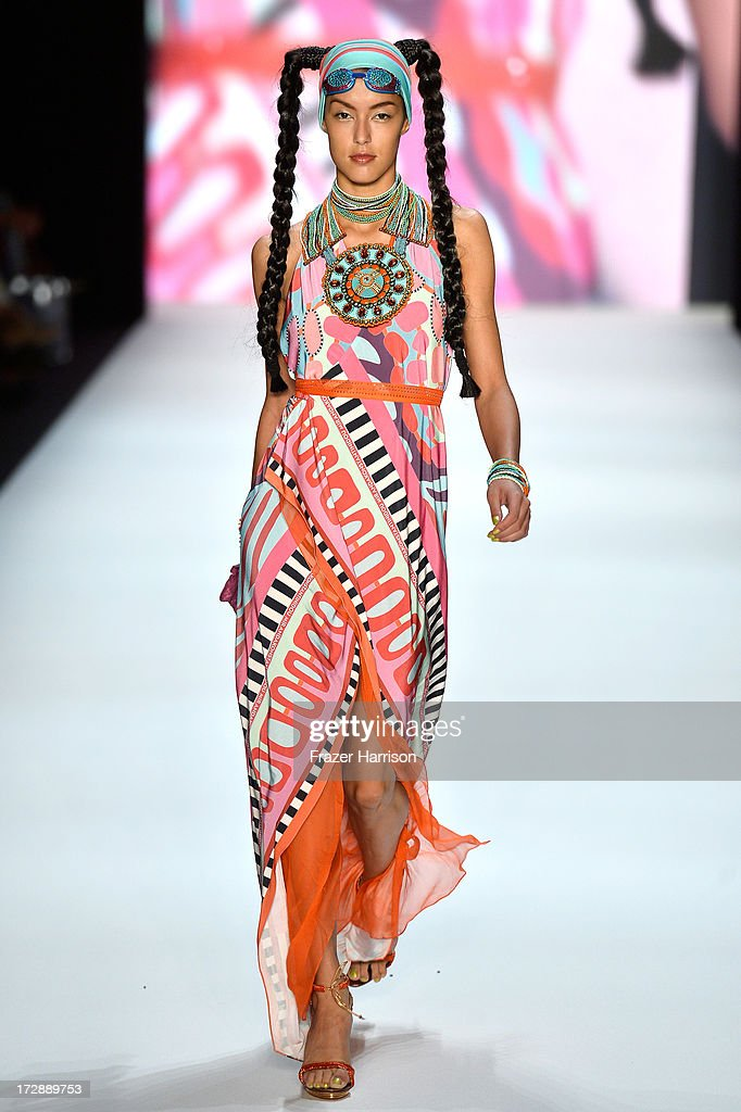 Model Rebecca Mir walks the runway at the Miranda Konstantinidou Show during the Mercedes-Benz Fashion Week Spring/Summer 2014 at Brandenburg Gate on July 5, 2013 in Berlin, Germany.