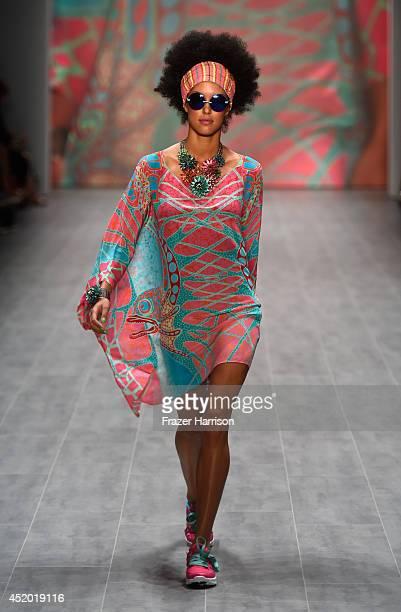Model Rebecca Mir walks the runway at the Miranda Konstantinidou show during the MercedesBenz Fashion Week Spring/Summer 2015 at Erika Hess...