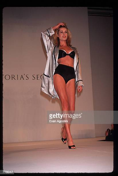 Model Rebecca Romijn displays lingerie at a Victoria's Secret fashion show February 6 1996 in New York City The lingerie chain presented a fashion...