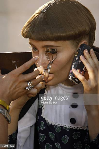 A model receives make up and hair styling backstage at the Christian Dior Fashion Show as part of Paris Fashion Week Spring/Summer 2007 on October 3...