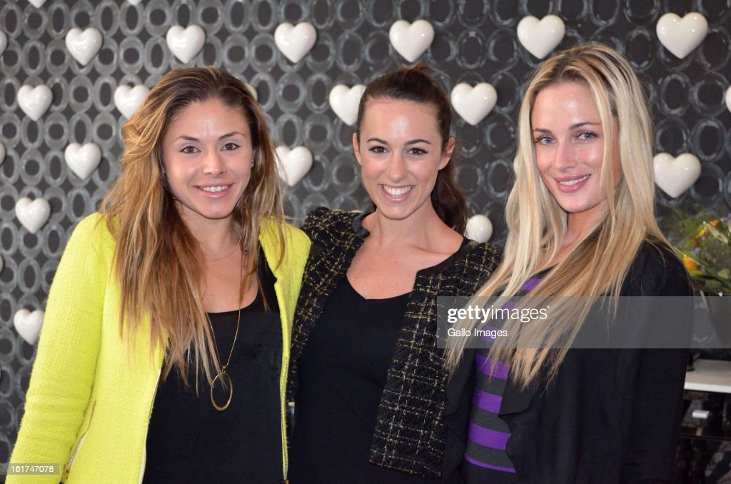 FHM model Reeva Steenkamp (R) poses with guests at her high tea birthday party at the Da Vinci Hotel on August 12, 2012 in Sandton, South Africa. Oscar Pistorius stands accused of murder after shooting girlfriend Reeva Steenkamp on the morning of February 14, 2013. His bail hearing has been postponed until February 19, 2013, with prosecutors stating they will pursue a charge of premeditated murder against him.