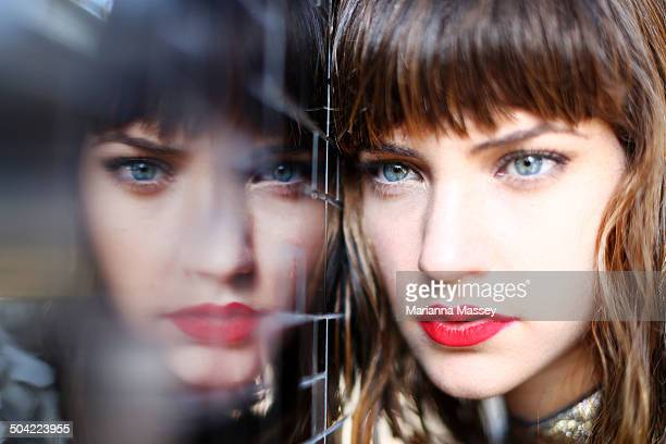 A model reflected in a mirrored wall