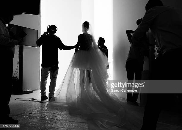 A model rehearses bacstage before the George Hobeika show as part of Paris Fashion Week Haute Couture Fall/Winter 2015/2016 at Palais De Tokyo on...