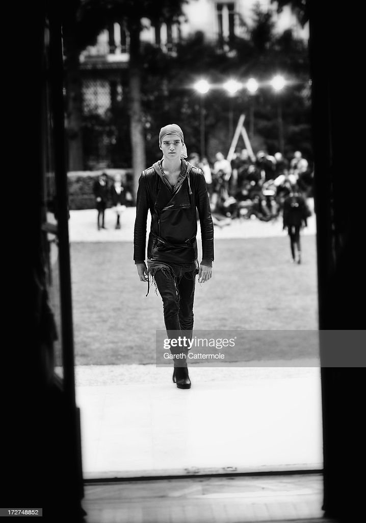 A model rehearses prior to the Rad Hourani show as part of Paris Fashion Week Haute-Couture Fall/Winter 2013-2014 on July 4, 2013 in Paris, France.