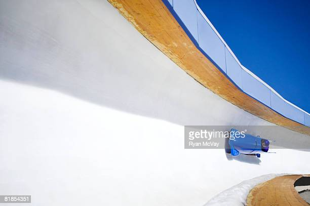 Blue twoman bobsled going down bobsled track at Utah Olympic Park Utah